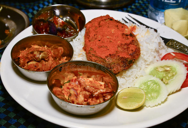 Fish Curry and rice. Indian Fish Curry with Rice. Also there are snails,oyesters as side dish stock images