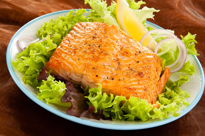 Fish dish. Fried salmon fillet with vegetables royalty free stock photo