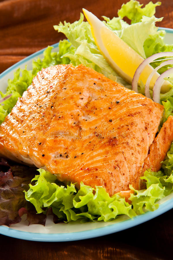 Fish dish. Fried salmon fillet with vegetables stock photography