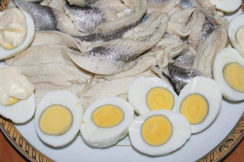Fish and eggs. On a plate royalty free stock images