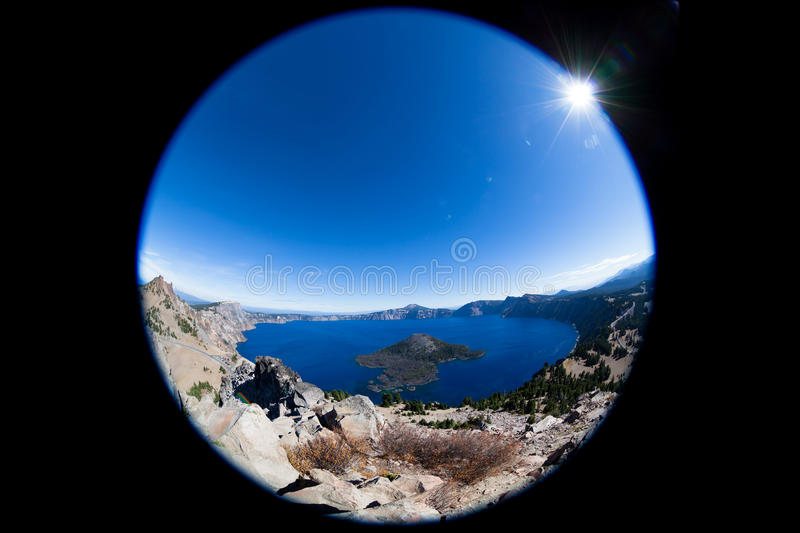 Fish-Eye Effect of Crater Lake National Park. A fish eye lens is used to capture Crater Lake National Park in Oregon showing how Mount Mazama exploded and left a royalty free stock image