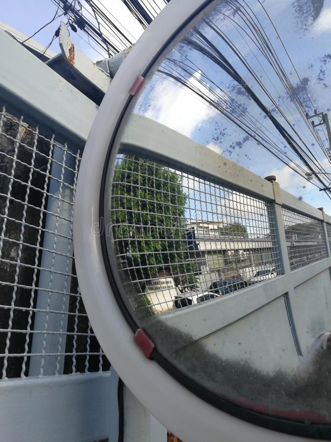 Fish eye lens glass has a convex look at the traffic in the alley with intersections. stock photo
