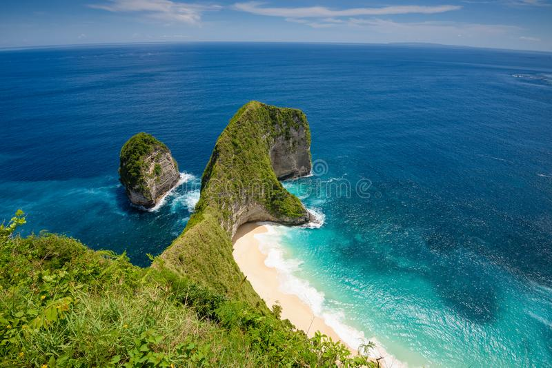 Kelingking beach on the island of Nusa Penida in Bali 2. A fish eye view looking down into the crystal clear waters of kelingking beach, on the island of Nusa royalty free stock photo