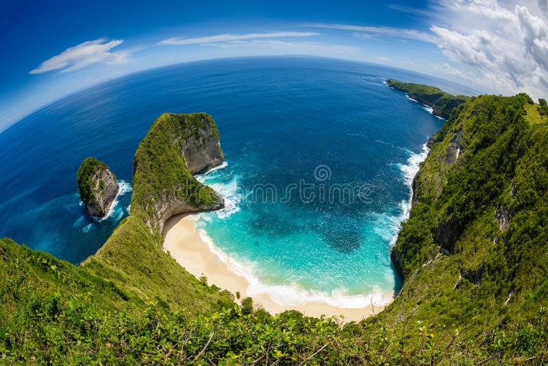 Kelingking beach on the island of Nusa Penida in Bali 3. A fish eye view looking down into the crystal clear waters of kelingking beach,surrounded and enclosed stock images