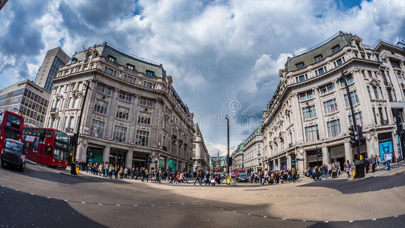 Fish eye view of Oxford Circus in London at peak time with car traffic and shoppers stock photo