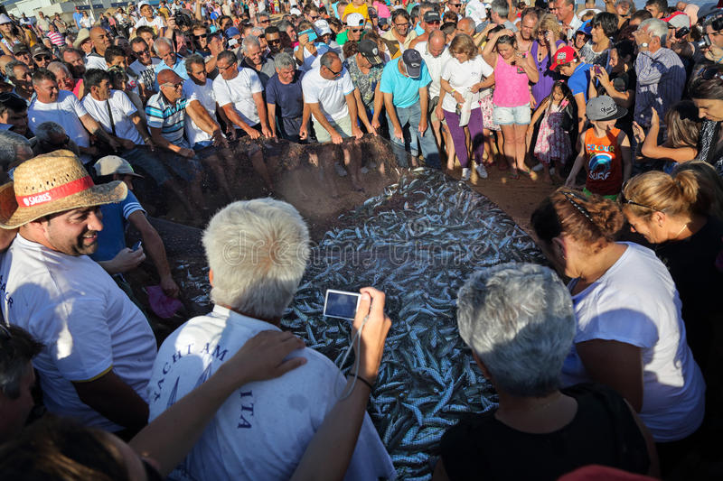 Fish festival in Quarteira, Portugal. MAY 31, 2014 Fish festival where fisherman are showing traditional fishing activity to general population and tourists in stock images