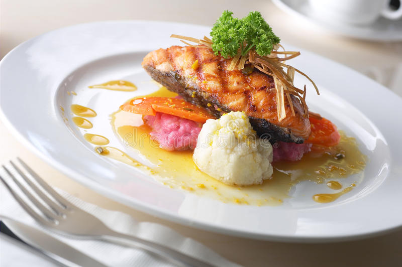 Fish filler. A plate of grill fish fillet royalty free stock photography