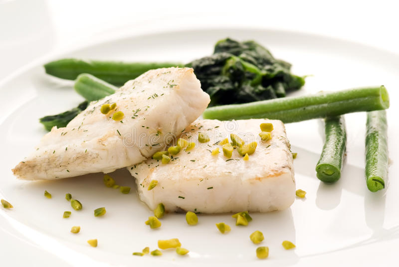 Fish fillet. With vegetable and pistachio stock image