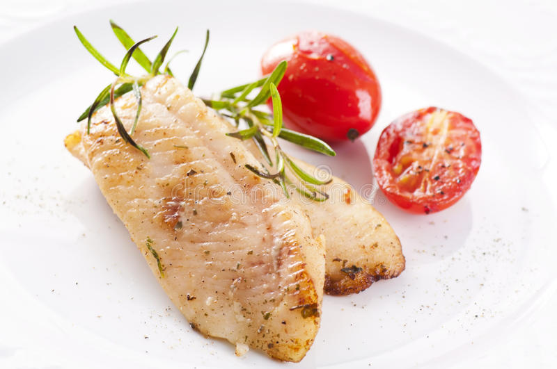 Fish fillet. Fried with fresh herbs stock photography