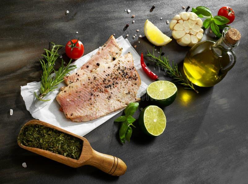 Fish fillet and seasoning stock photos
