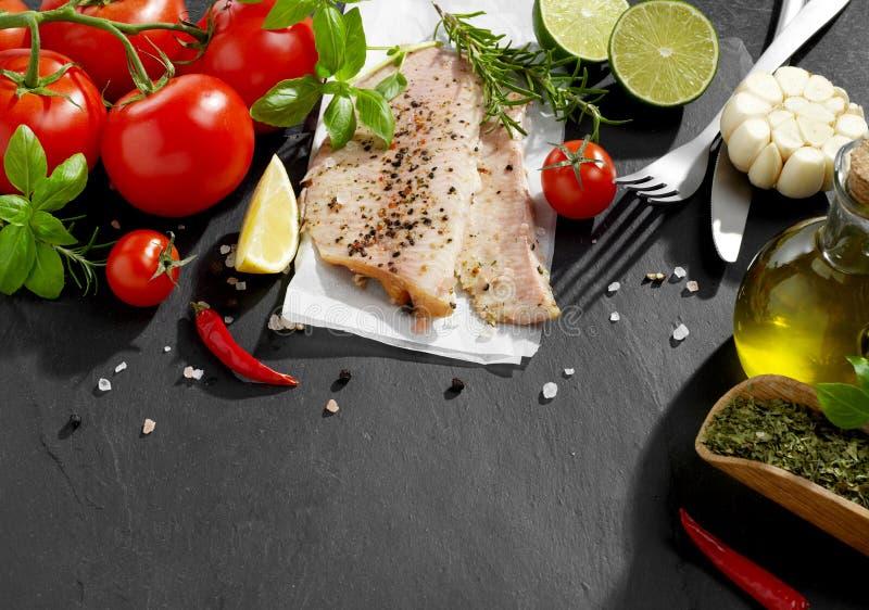 Fish fillet and seasoning royalty free stock photo
