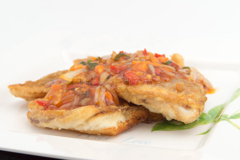 Fish Fillet with three flavor spicy sauce. Contains garlic, chili sauce, mushrooms, white onions, bell pepper, basil leafs royalty free stock photos