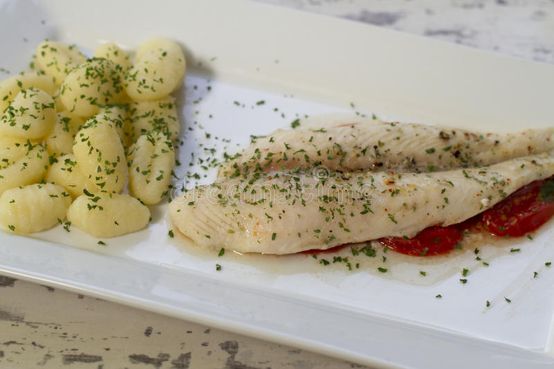 Fish Fillet On Tomato Bed With Gnocchi Stock Images