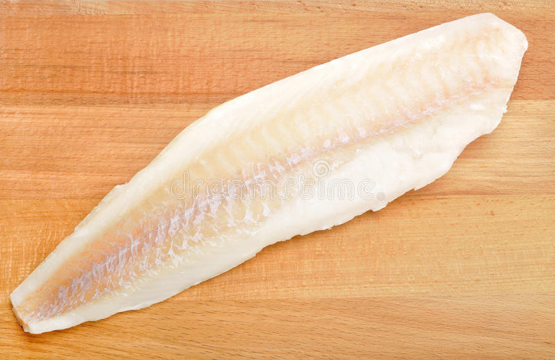 Fish fillets. On a wooden board stock images