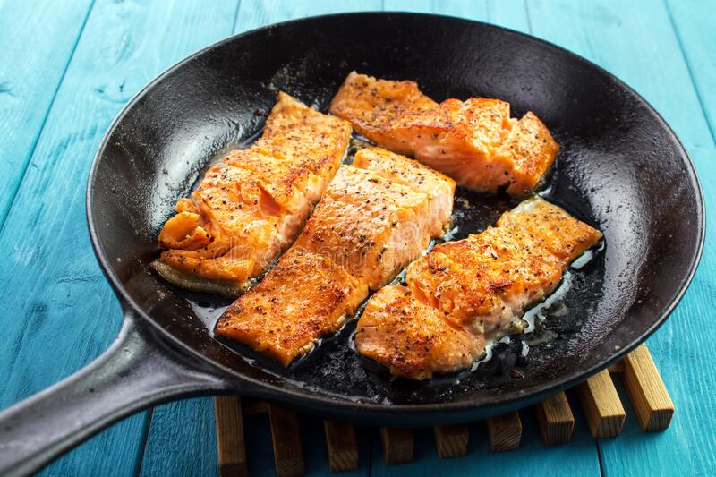 Fish fillets on skillet royalty free stock image