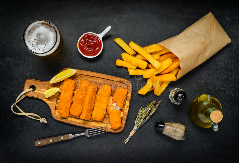 Fish Fingers with Paper Bag of French Fries royalty free stock image