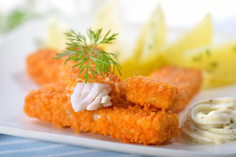 Fish fingers with potatoes royalty free stock image