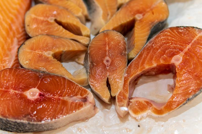 Fish, fish steaks and fish fillets lie on the ice in the supermarket royalty free stock images