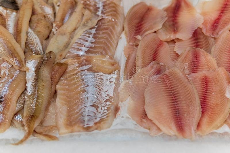 Fish, fish steaks and fish fillets lie on the ice in the supermarket stock image