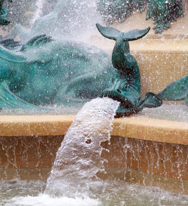 Fish Fountain. Bronze fish spouting water, as part of a fountain royalty free stock photography
