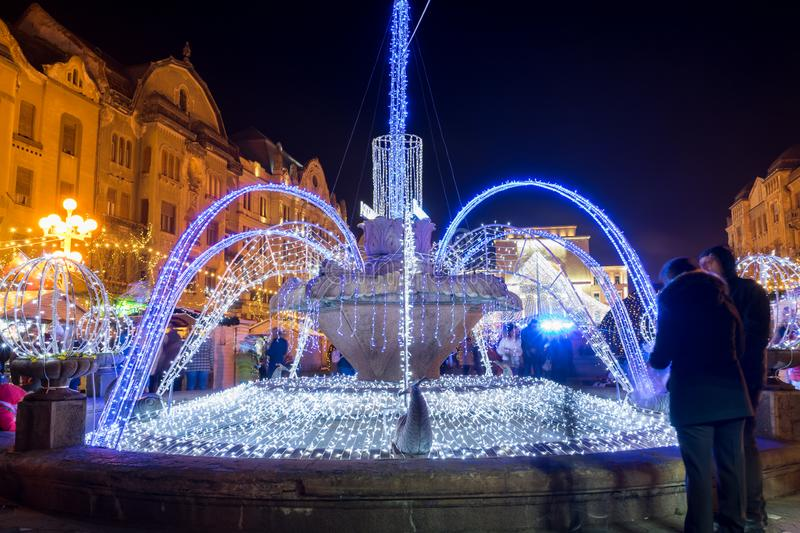 The fish fountain. Illuminated fountain known as `The fish fountain`. Long exposure royalty free stock image