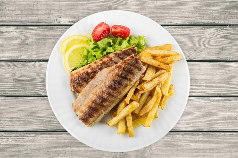 Fish. French Fries Grilled Fried Fillet Dinner Tilapia royalty free stock photography