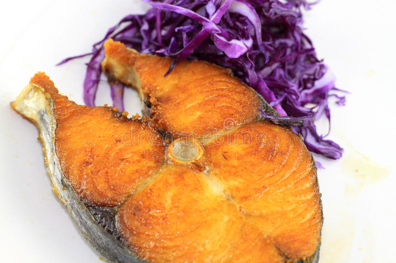 Fish fry with red cabbage stock photo