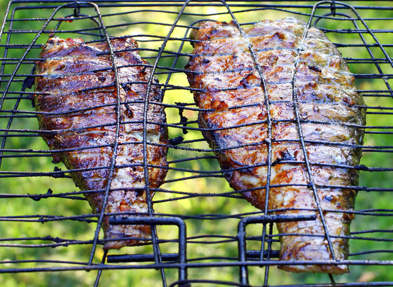 Fish on the grill. Summer barbecue concept. Close up with shallow DOF royalty free stock photo