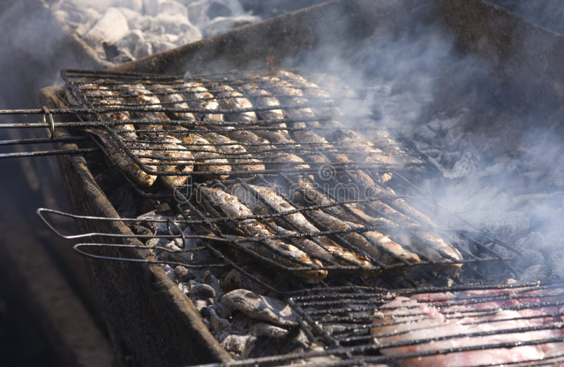 Fish grilling in Essaouira. Over charcoal royalty free stock photo