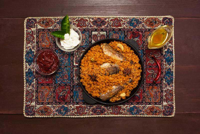 Fish Kabsa dish. Middle eastern food. Top view.  stock photo