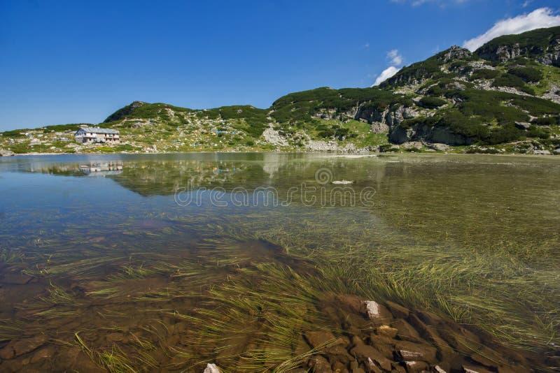 The Fish lake and mountain hut, The Seven Rila Lakes, Rila Mountain. Bulgaria royalty free stock images