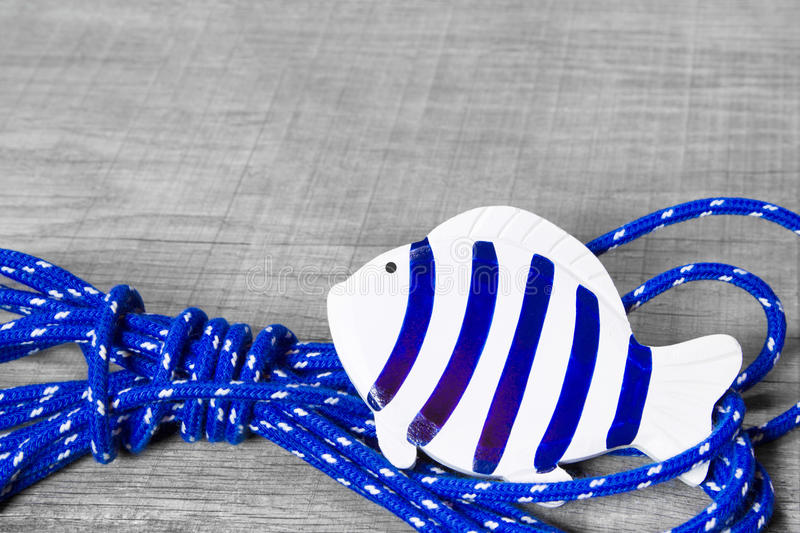 Fish maritime decoration. Fish decoration at the sea as a maritime background of wood royalty free stock photos