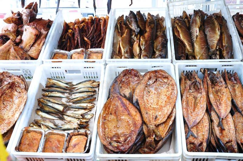 Fish market. Variety of smoked fish at market royalty free stock photos