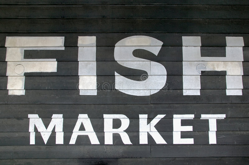 Fish Market. Painted on the side of a wooden building royalty free stock photos
