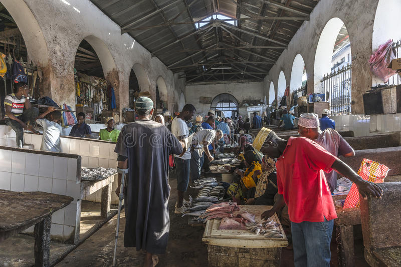 Fish market in Stone Town. Sellers offer fresh fish and seafood in the city market Stone Town on Zanzibar, Tanzania. Africa stock image