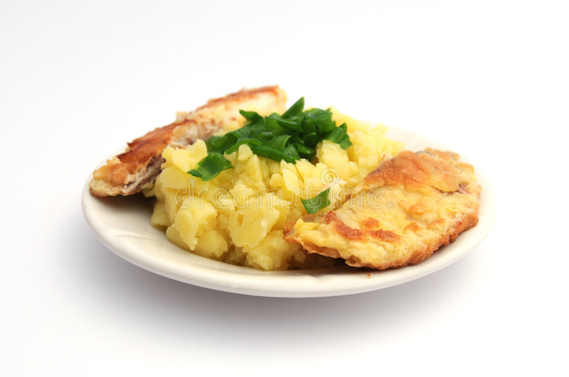 Fish and mashed potatoes royalty free stock photography