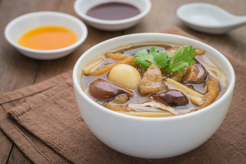 Fish maw soup in bowl stock photography