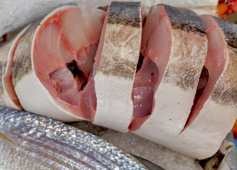 Fish meat on ice. Raw fish meat on ice seamarket. Seafood on ice, background Sea food royalty free stock photo