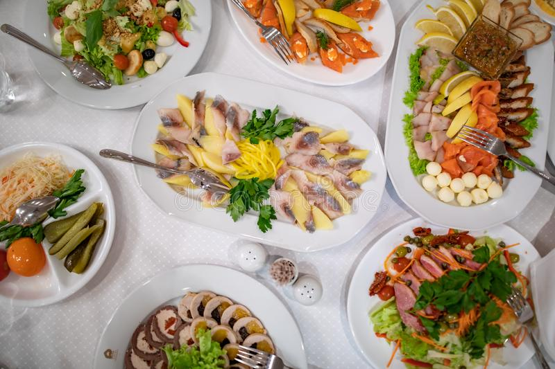 Fish and meat meals variety flat lay. Top view on buffet with assortment of healthy hearty food. Buffet, banquet, appetizer royalty free stock photos