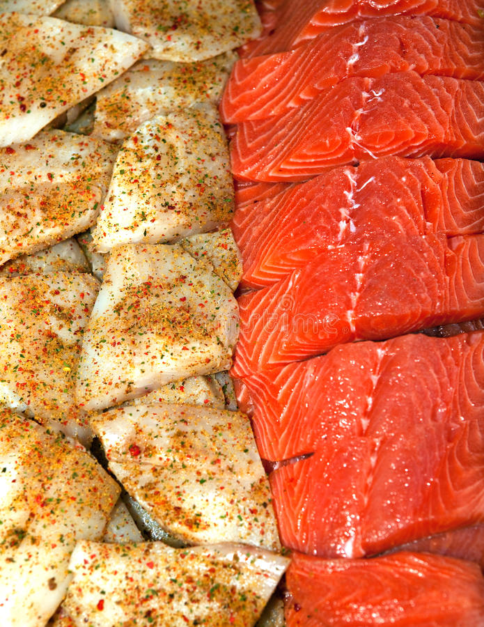 Fish meat prepared for grilling. Two kinds of fish meat prepared for grilling stock images