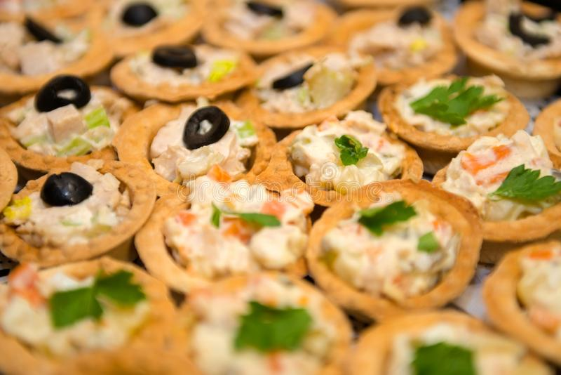Fish and meat salads in tartlets stock images