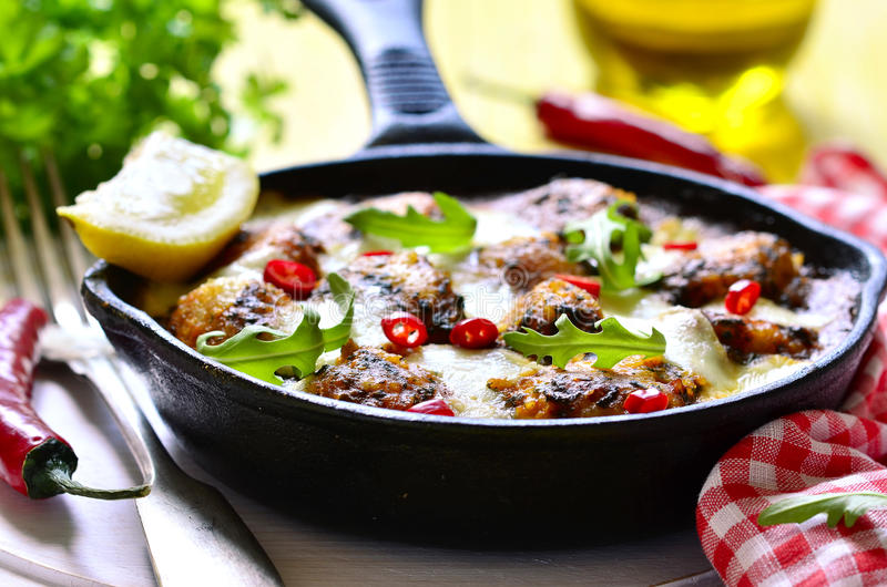 Fish meatball baked in frying pan. royalty free stock photos