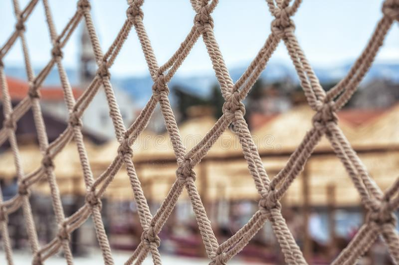 Fish net fence of a beautiful luxurious beach resort. Close up detail royalty free stock photography