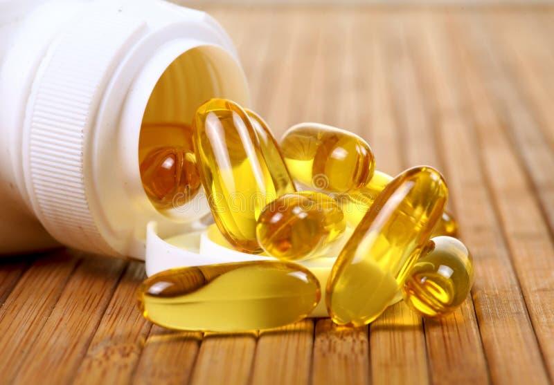 Fish oil capsules. Closeup shot of fish oil capsules royalty free stock image