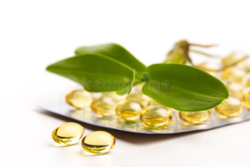 Fish oil in capsules. For health and immunity isolated on white. Image royalty free stock photo