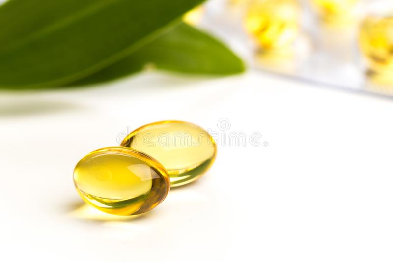Fish oil in capsules. For health and immunity isolated on white. Image royalty free stock photos
