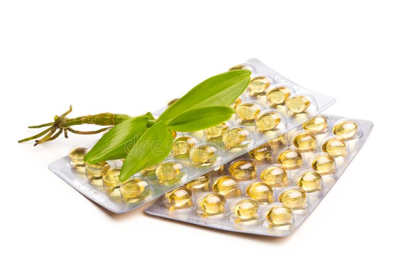 Fish oil in capsules. For health and immunity isolated on white. Image royalty free stock image