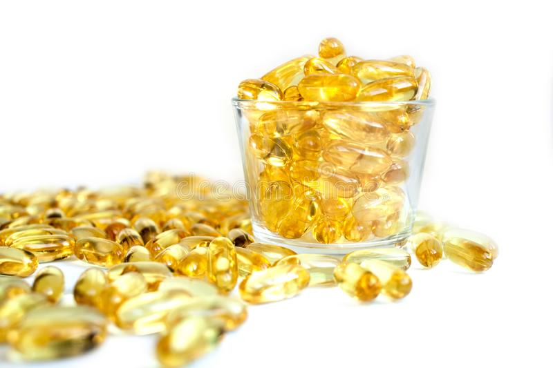 Fish oil capsules packed with omega 3 6 9 in a jar healthy lifestyle space for text. A lot of fish oil omega 3 6 9 capsules in a jar closeup background. sports royalty free stock photos
