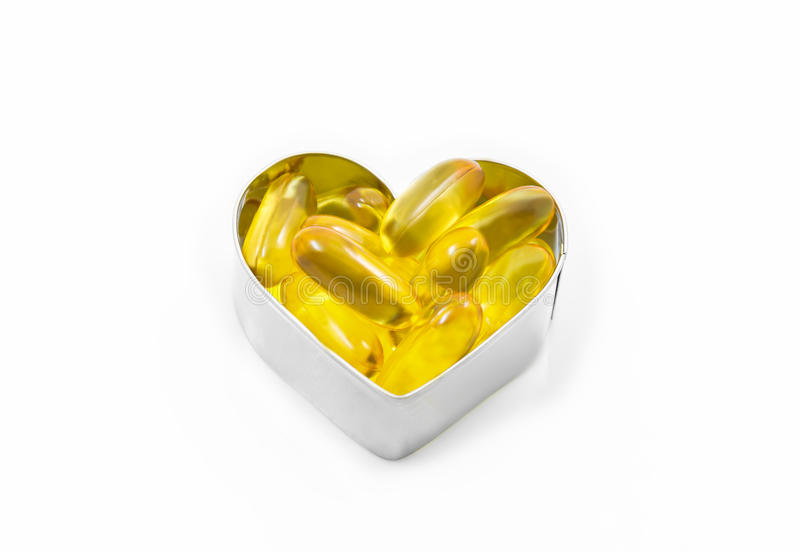 Fish Oil in hear shape box isolated stock images