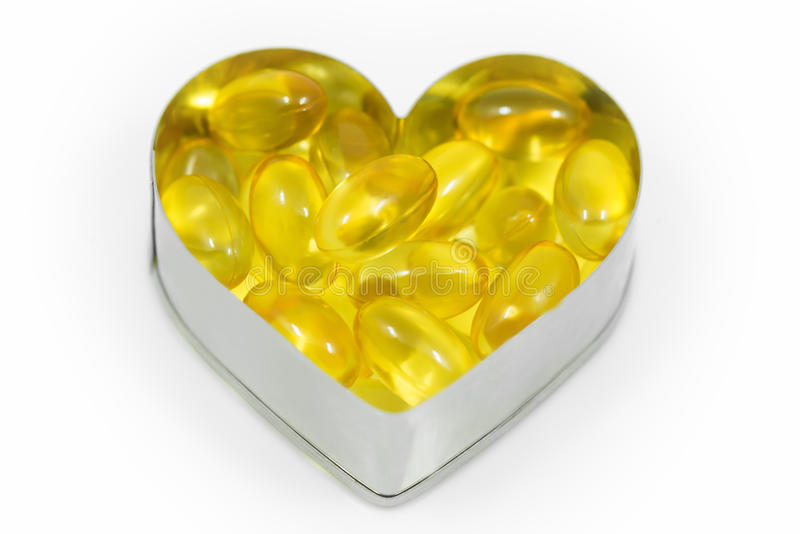 Fish oil on heart royalty free stock photography